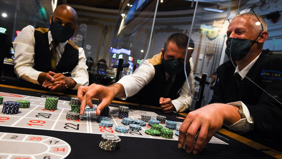 Men wearing face mask in a casino die to the coronavirus pandemic